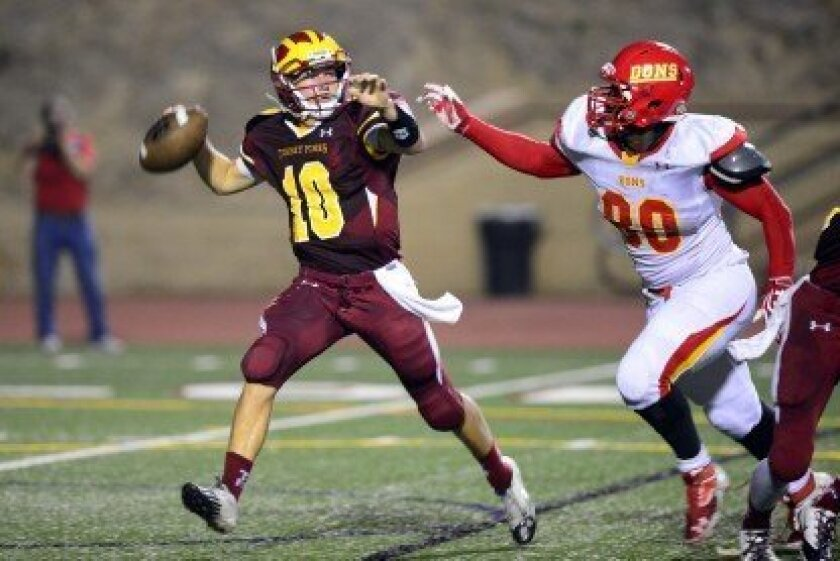 Torrey Pines quarterback Pete Mitchell feels the rush from Cathedral Catholic defensive end Kyle Davis in the Sept. 6 matchup between the two local high schools. The Dons won 10-0. Photo/Anna Scipione