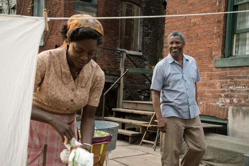 "Viola Davis as Rose Maxson and Denzel Washington as Troy Maxson in ""Fences."""