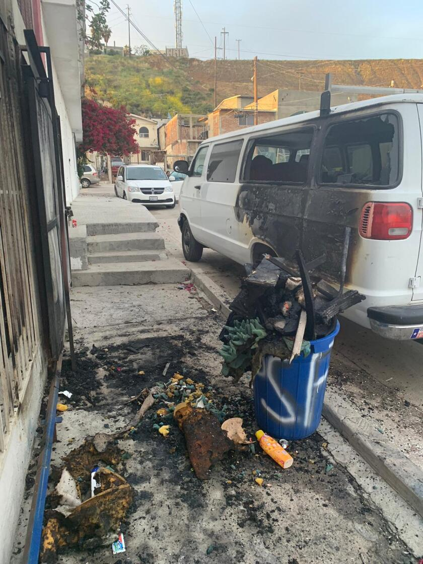 The vehicle of activist Irineo Mujica, the director of Pueblo Sin Fronteras, is seen here in front of his home in the aftermath of someone setting fire to the car and trying to set fire to his residence while he was inside.