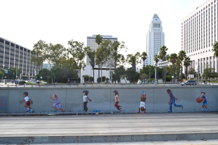 """""""L.A. Freeway Kids,"""" a mural by Glenna Avila by the 101 Freeway in downtown Los Angeles, is part of the Google Street Art project. The online database preserves more than 10,000 often-ephemeral artworks in photos and maps them around the globe."""