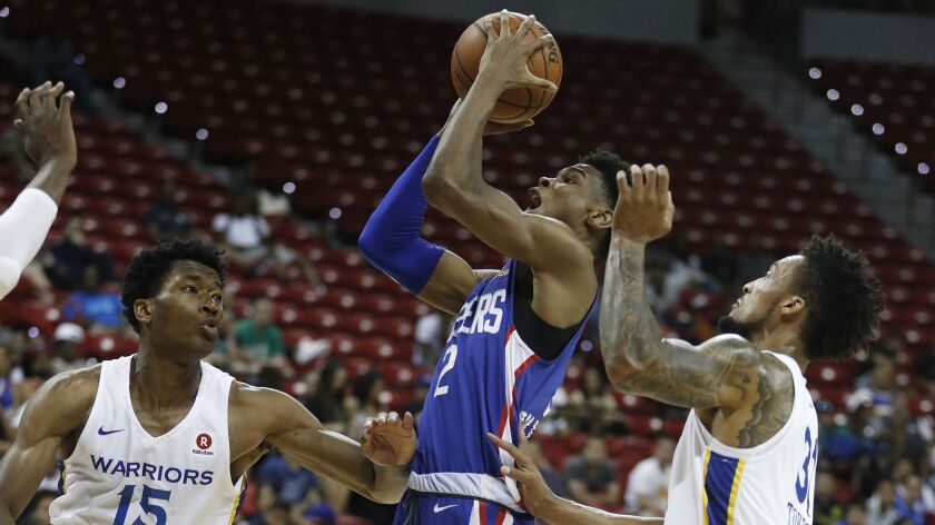 Golden State Warriors' Damian Jones, left, and J.P Tokoto guard Los Angeles Clippers' Shai Gilgeous-
