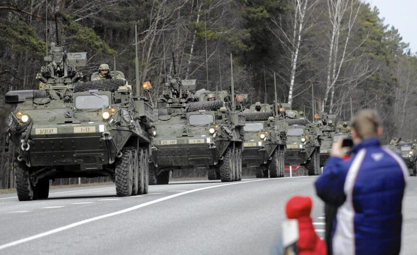 A U.S. Army convoy rolls through Liepupe, Latvia, on its way from Estonia to Germany. The Ukraine conflict unnerves many in Latvia.