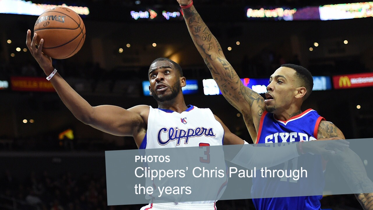 Chris Paul, left, puts up a shot in front of Philadelphia 76ers forward Malcolm Thomas on Jan. 3, 2015. Paul, who was acquired by the Clippers in 2011, is considered one of the NBA's top point guards.