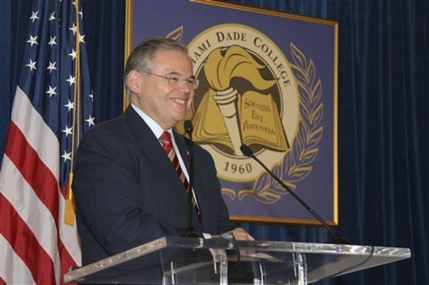 """In this Jan. 31, 2010, image released by Miami Dade College, shows Sen. Robert Menendez, D-N.J., speaks at the signing of his book """"Growing American Roots"""" at the college in Miami. Menendez sponsored legislation with incentives for natural gas vehicles conversions that would benefit the biggest political donor to his re-election, Dr. Salomon Melgen, the same eye doctor whose private jet Menendez used for two personal trips to the Dominican Republic, an Associated Press investigation found. (AP P"""