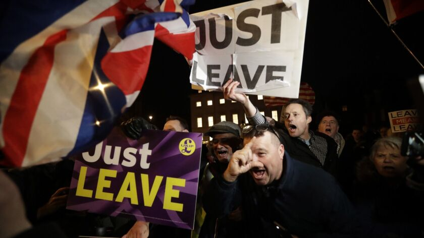 Demonstrators who favor Britain leaving the European Union outside Parliament on March 14.