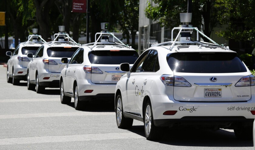 Google self-driving cars line up in Mountain View, Calif., in 2014.