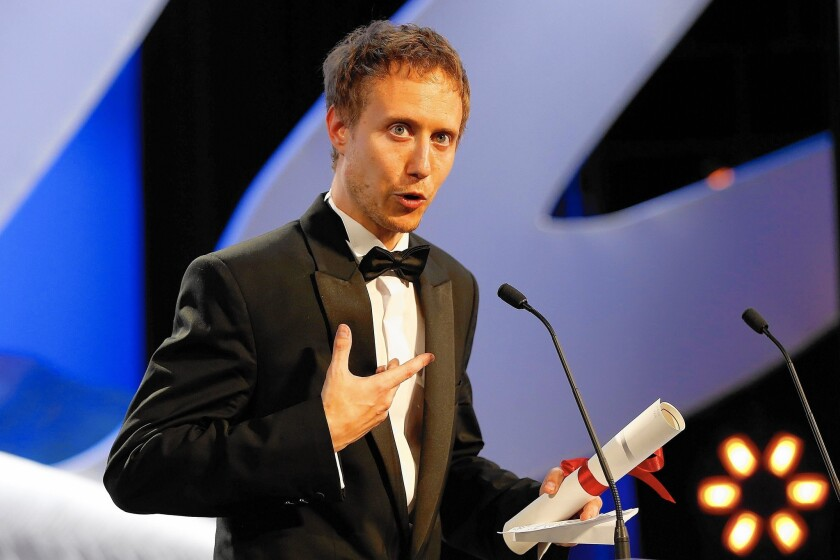 Hungarian director Laszlo Nemes accepts the Grand Jury Prize during the closing ceremony of the 68th Cannes Film Festival in Cannes, southeastern France.