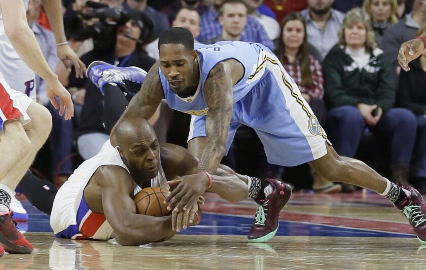 Detroit Pistons forward Anthony Tolliver, left, and Denver Nuggets forward Will Barton reach for the loose ball during the first half of an NBA basketball game, Wednesday, Feb. 10, 2016 in Auburn Hills, Mich. (AP Photo/Carlos Osorio)