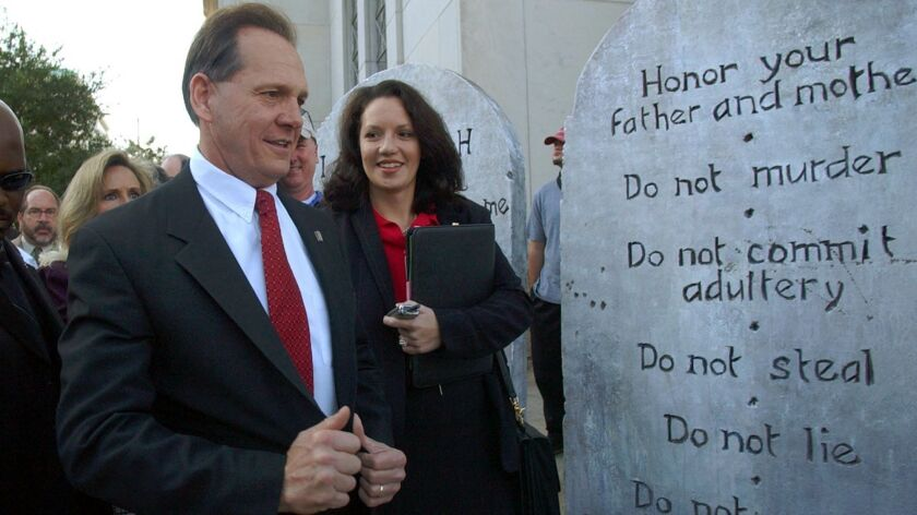 Alabama GOP senate candidate Roy Moore looking at a Ten Commandments display in Montgomery, Ala. in 2003.