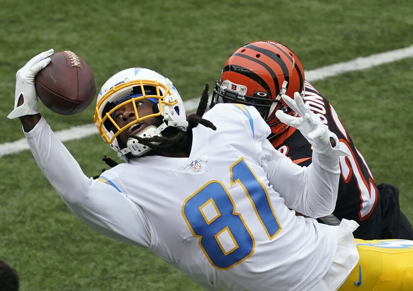 Los Angeles Chargers' Mike Williams (81) tries to make a catch against Cincinnati Bengals' William Jackson (22) during the first half of an NFL football game, Sunday, Sept. 13, 2020, in Cincinnati. The pass was incomplete. (AP Photo/Darron Cummings)