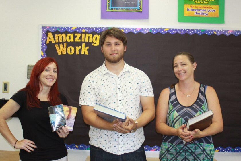 New Muirlands Middle School teachers Frances Disney, Matthew Hartje and Amy Thomas arrive on campus Aug. 15 to start setting up their classrooms.