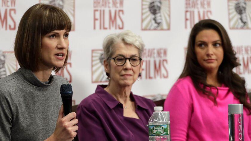 Rachel Crooks, left, Jessica Leeds, center, and Samantha Holvey attend a news conference, Monday, De