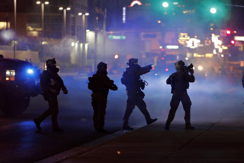 Police walk through tear gas as they try to disperse protesters in Las Vegas last week.