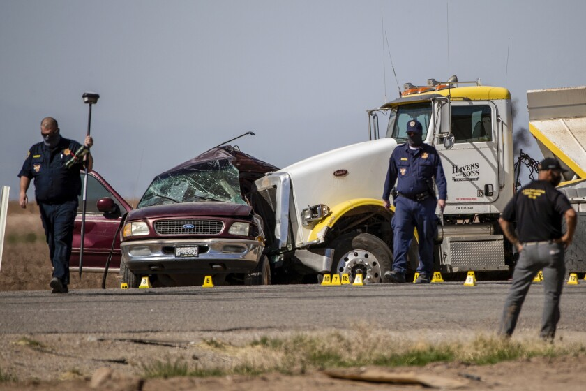 CHP investigates the scene where an SUV carrying 25 people collided with a semi-truck killing 13