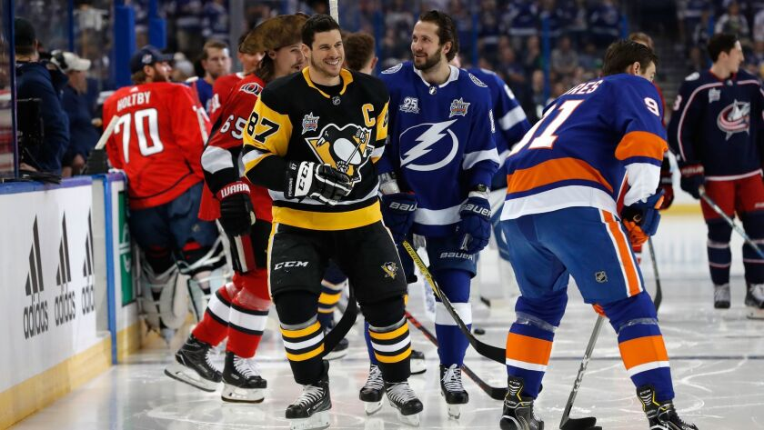 Sidney Crosby (87) of the Pittsburgh Penguins and Nikita Kucherov of the Tampa Bay Lightning warm up prior to the NHL All-Star Skills Competition at Tampa, Fla.