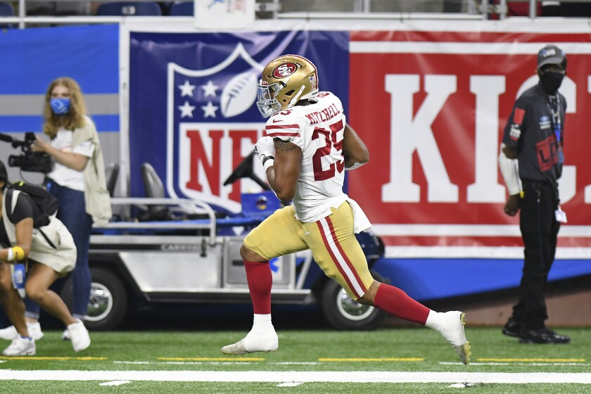 San Francisco 49ers running back Elijah Mitchell runs for a 38-yard touchdown against the San Francisco 49ers in the first half of an NFL football game in Detroit, Sunday, Sept. 12, 2021. (AP Photo/Lon Horwedel)