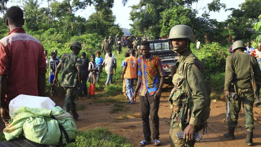 In this photo taken Friday, Oct 5, 2018, Congolese Soldiers patrol in an area civilians were killed