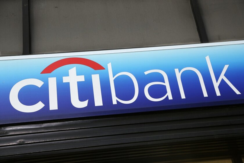 """FILE - In this Jan. 15, 2015 photo, a Citibank sign hangs above a branch office in New York. The Consumer Financial Protection Bureau on Tuesday, July 21, 2015 said that Citi will have to issue refunds to 8.8 million affected consumers who paid for credit card add-on products and services, like credit score monitoring or """"rush"""" processing of payments. (AP Photo/Mark Lennihan, File)"""