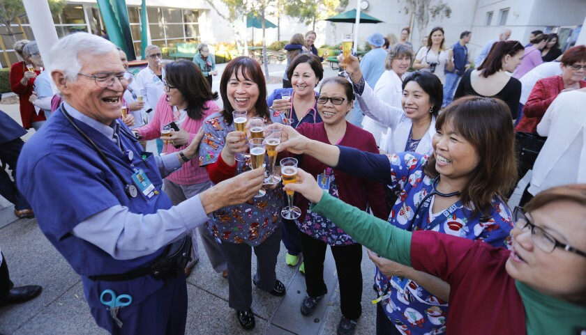 Dr. Melvin Ochs, left, retired last week after a storied career of nearly 50 years at Scripps Mercy Hospital Chula Vista where he was the emergency department director. He celebrated with emergency room nurses and staff during a small gathering at the hospital.