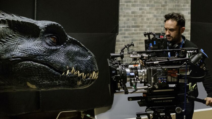 "Director J.A. BAYONA with the Indoraptor on the set of ""Jurassic World: Fallen Kingdom."" When the is"
