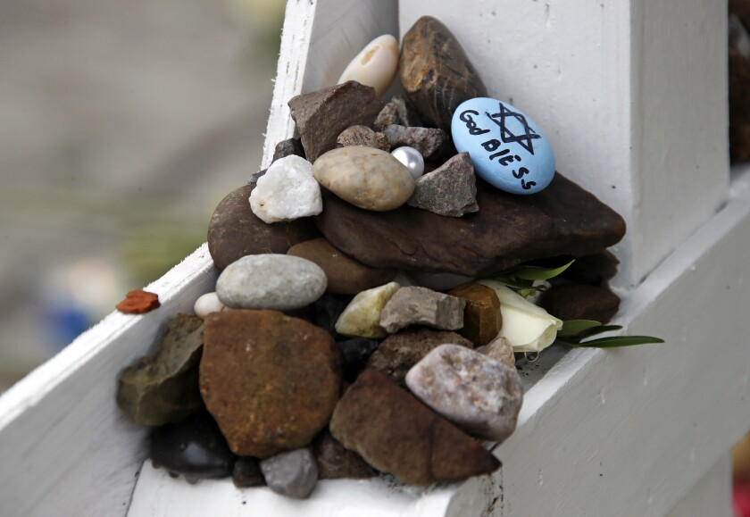 These are stones placed Thursday, Nov. 1, 2018, at a makeshift memorial outside the Tree of Life Syn
