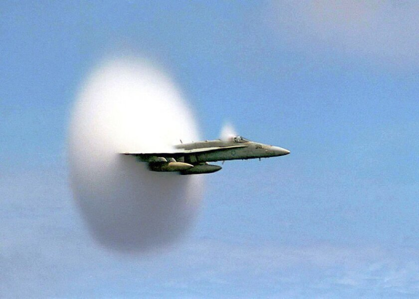 This is an archive image of an FA-18 Hornet breaking the sound barrier in July 1999.