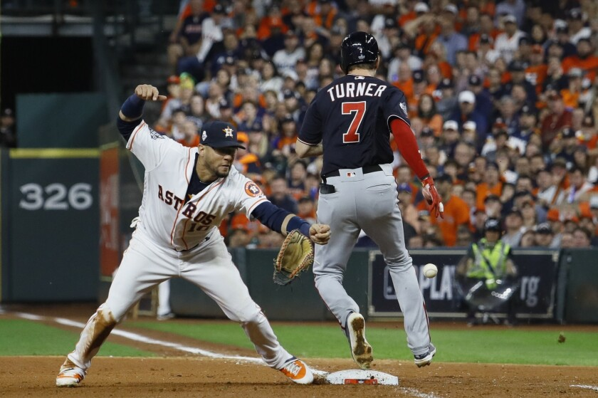 Washington Nationals' Trea Turner touches first as Houston Astros' Yuli Gurriel tries to make a play during Game 6 of the World Series on Oct. 29.