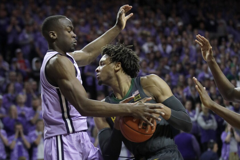 Baylor forward Freddie Gillespie, right, is covered by Kansas State forward Makol Mawien, left, during the first half of an NCAA college basketball game in Manhattan, Kan., Monday, Feb. 3, 2020. (AP Photo/Orlin Wagner)