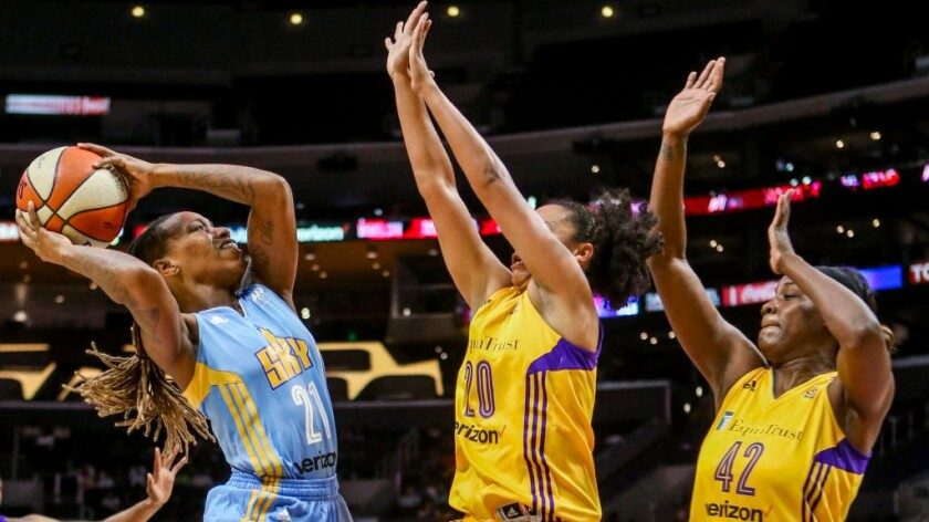 Sky guard Jamierra Faulkner goes up for a shot under pressure from Sparks guard Kristi Toliver and center Jantel Lavender, right, during the first half of Game 2 of a semifinal playoff game on Sept. 30.