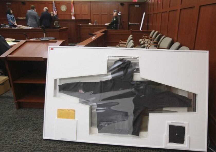 Trayvon Martin's hoodie is shown in a Florida courtroom. The Smithsonian has denied reports that it was interested in acquiring the hoodie for its collections.