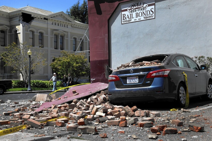 Falling bricks caused damage in downtown Napa in the Aug. 24 quake. Napa was too close to the epicenter to receive a warning, but advancing technology may soon have that capability.