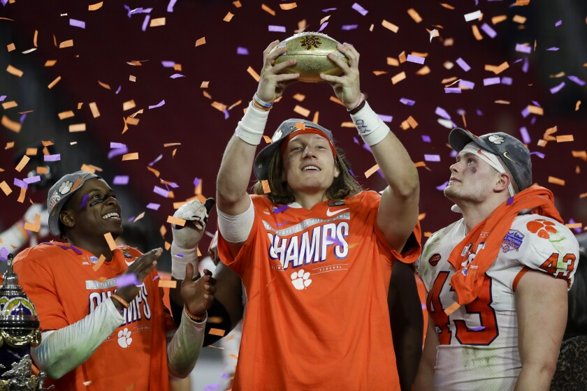 Clemson quarterback Trevor Lawrence, middle, and teammates celebrate their Fiesta Bowl victory Dec. 29, 2019.