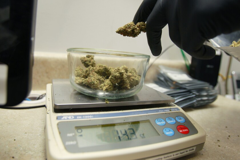 A medical marijuana order is measured at Outliers Collective in El Cajon.
