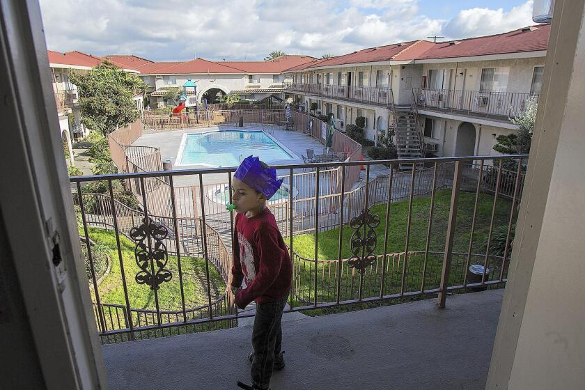 A boy plays at his home at the Costa Mesa Motor Inn in 2012.