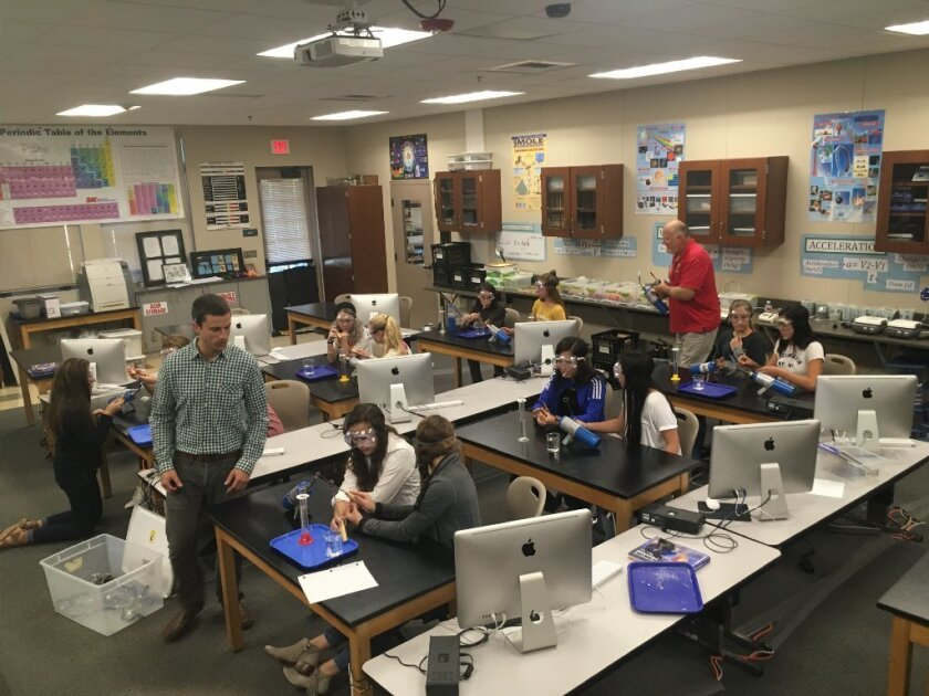 John Galipault, front, and Dave Warner, in back, lead a science class at R. Roger Rowe.