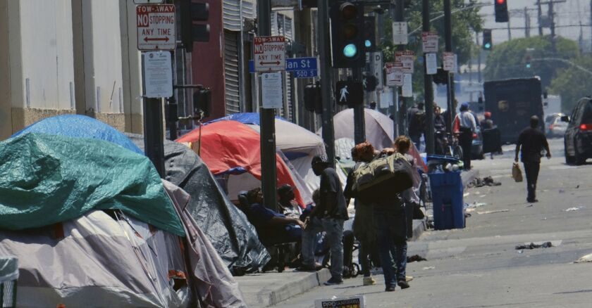 Homeless people's tents line a street in downtown Los Angeles on May 30, 2019.