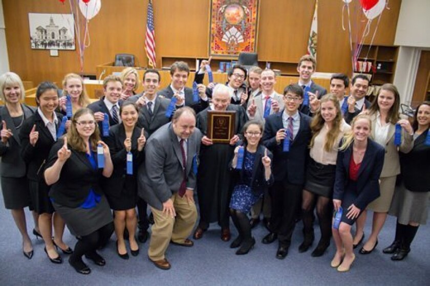 After their victory, the Bishop's School team celebrates their victory in the courtroom. Courtesy