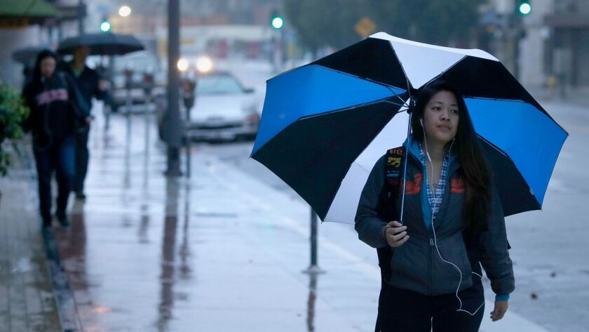 Light rain falls across Southern California with more expected throughout the day and weekend.