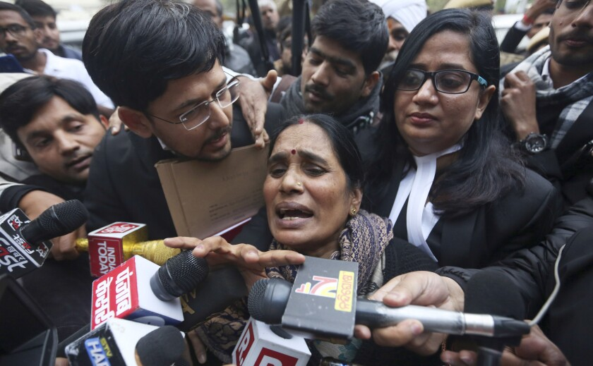 Asha Devi, mother of the victim of the fatal 2012 gang rape on a moving bus, speaks to the media as she leaves a court in New Delhi, India, Tuesday, Jan. 7, 2020. A death warrant was issued Tuesday for the four men convicted in the 2012 gang rape and murder of a young woman on a New Delhi bus that galvanized protests across India and brought global attention to the country's sexual violence epidemic. A New Delhi court scheduled the hangings for Jan. 22, the Press Trust of India news agency reported. (AP Photo)