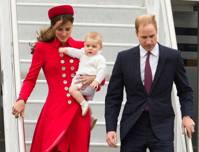 Prince William and Catherine arrive in Wellington, New Zealand, with their son Prince George. The family was scheduled to be New Zealand April 7-16. The duchess wears a scarlet Catherine Walker coat and a Gina Foster hat embellished with silver fern-shaped diamond and platinum brooch. The silver fern is New Zealand's emblem.