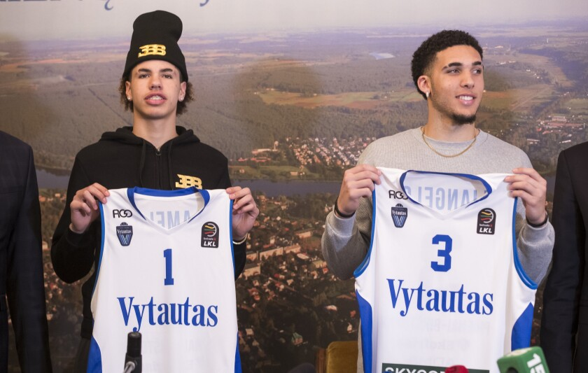 In this Friday, Jan. 5, 2018, file photo, American basketball players LiAngelo Ball, right, and his brother, LaMelo, display their shirts after signing with Lithuanian team BC Prienai - Birstonas Vytautas, during a news conference at the Harmony park hotel in Vaizgaikiemis village, Prienai district, Lithuania. The brothers went scoreless in their pro basketball debut, finishing a combined 0 for 7 on Saturday, Jan. 1,3, 2018.