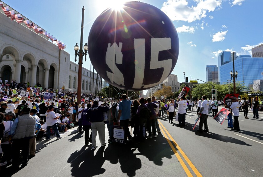 Workers rally outside Los Angeles City Hall on Nov. 10, 2015, to press demands for a minimum wage of $15 per hour.