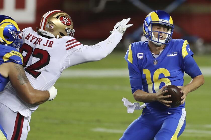 The San Francisco 49ers' pass rush pressures Rams quarterback Jared Goff.