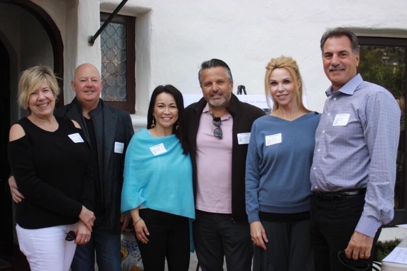 Historic homeowners Susan and David Ketring, Lisa and Raul Albanez, and Debra and Don Duford