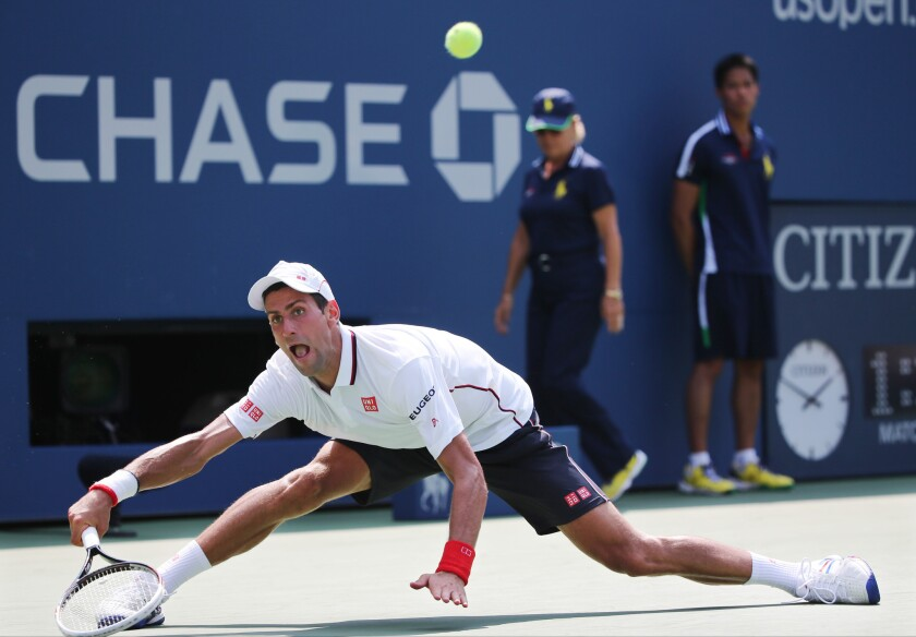 Novak Djokovic returns a shot to Kei Nishikori during Saturday's semifinals of the U.S. Open.