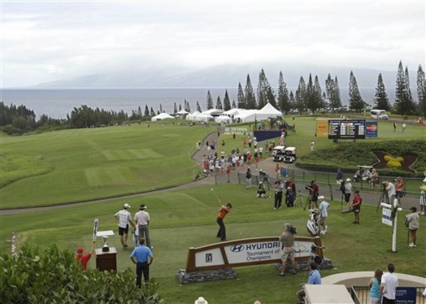 Camilo Villegas, of Colombia, hits from the first tee during the first round of the Hyundai Tournament of Champions golf tournament in Kapalua, Hawaii Thursday, Jan. 6, 2011. (AP Photo/Eric Risberg)