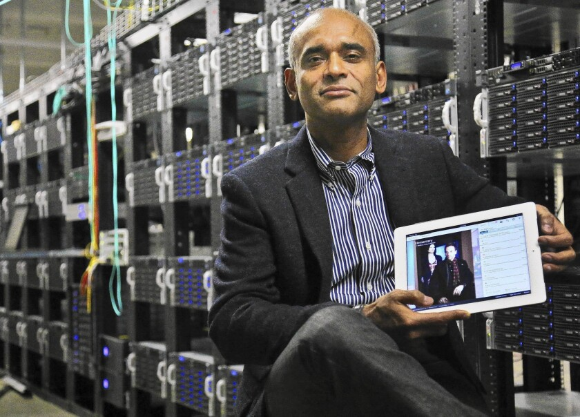 "CEO and founder Chet Kanojia said that if Aereo loses the Supreme Court case, ""it may mean the end of our company."" Above, he shows a tablet displaying Aereo's technology in 2012."