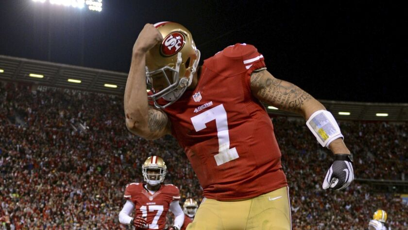 Colin Kaepernick celebrates after running in a touchdown in the first quarter against the Green Bay Packers during the NFC Divisional Playoff Game at Candlestick Park on January 12, 2013 in San Francisco.