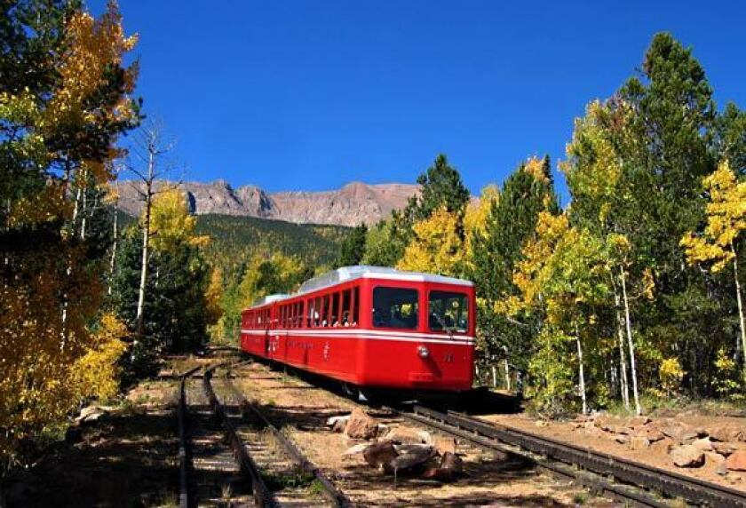 Amid a forest of aspen, the cog railway passenger train makes its climb up Pikes Peak in eastern Colorado.