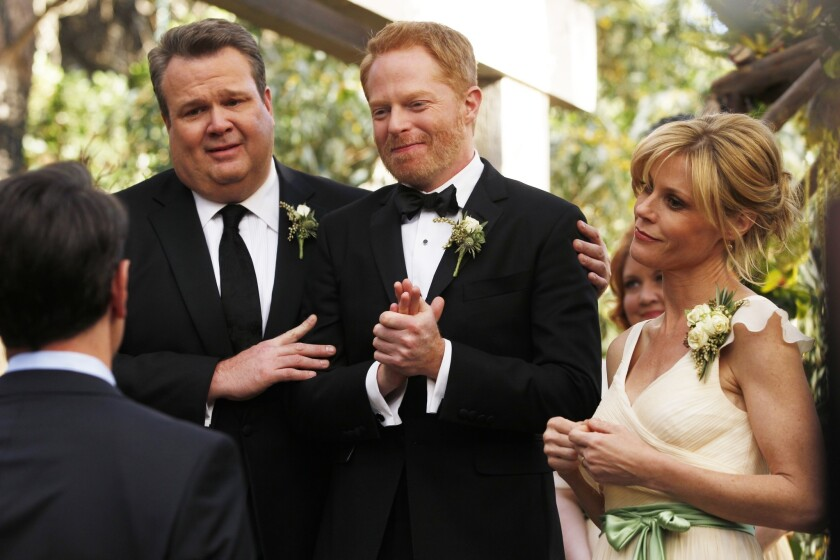 """Eric Stonestreet, left, Jesse Tyler Ferguson and Julie Bowen in """"Modern Family."""""""